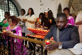 Africa saints pilgrimage. Catholic Mass. St-Maurice abbey. Faith. Church. Pray. Candles.